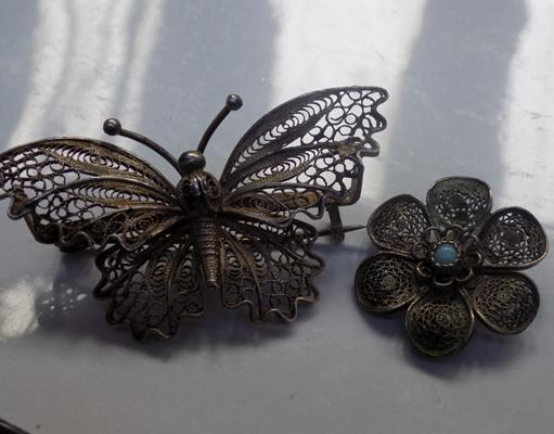 2x Silver filigree brooches-1 butterfly