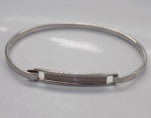 Silver bangle with white stone