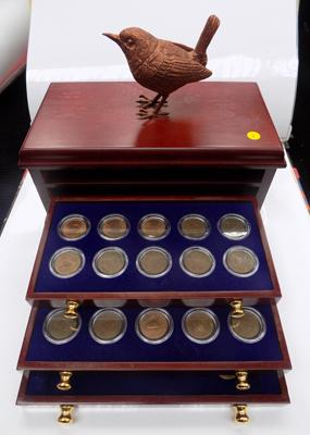 Complete collection of Wren farthings in coin collector mini cabinet