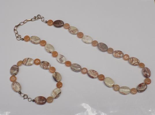 Silver clasped gemstone necklace and matching bracelet
