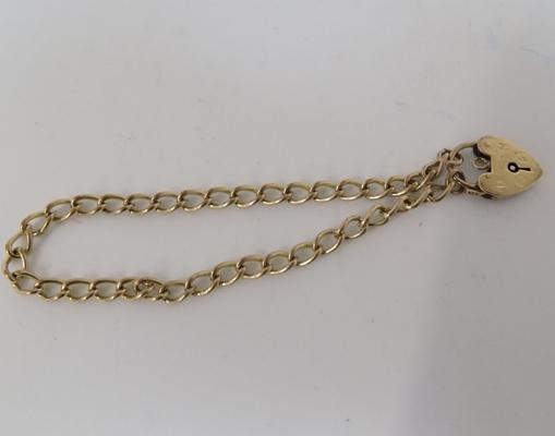 9ct gold bracelet with heart locket