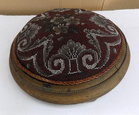 Antique Victorian beadwork footstool, approx. 20 inches in diameter