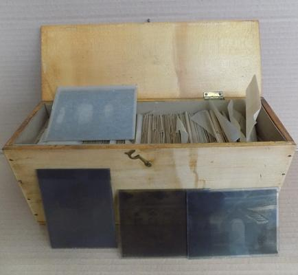 Wooden box of more than 60 glass slides