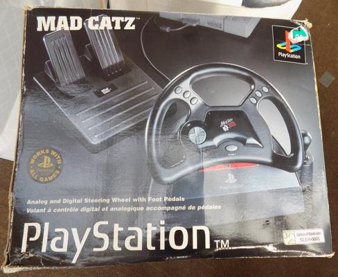Boxed Mad Catz Playstation wheel set