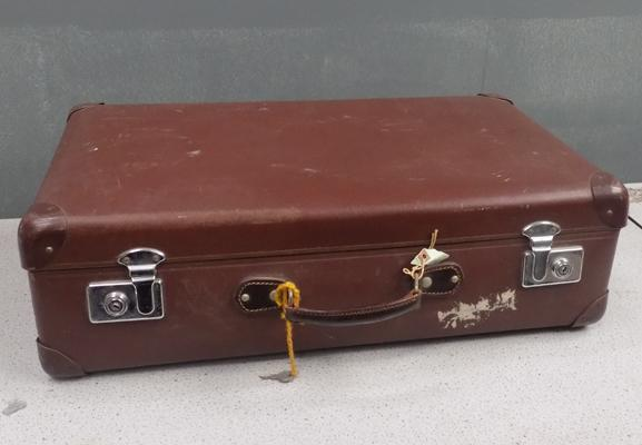 Vintage globe trotter suitcase with key
