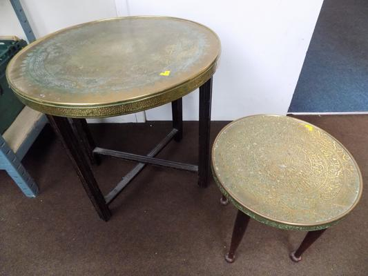 Pair of brass topped, relief decorated occasional tables