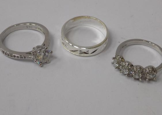 Three 925 silver rings - all approx. size M