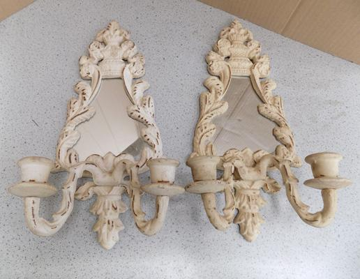 Pair of metal candle sconces with mirrors