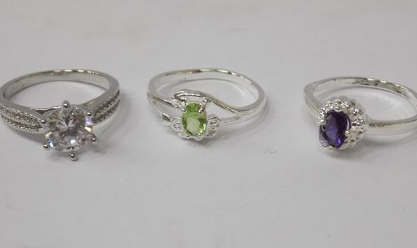 Three 925 silver rings - all approx. size Q