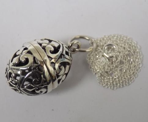 Silver egg pendant on silver chain