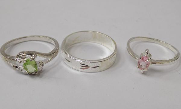 Three 925 silver rings - all approx. size R