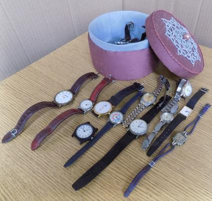 Embroidered jewellery box containing watches