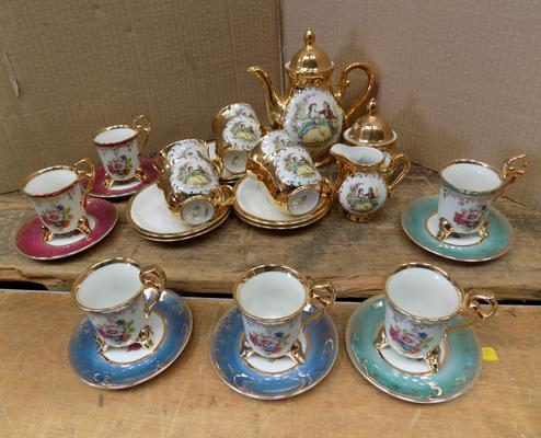 Small gold gilt coffee set + six cups & saucers