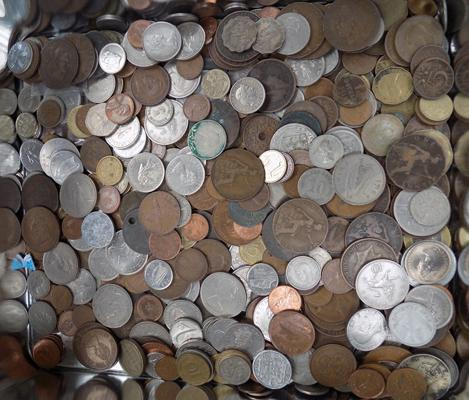Large tin of coins