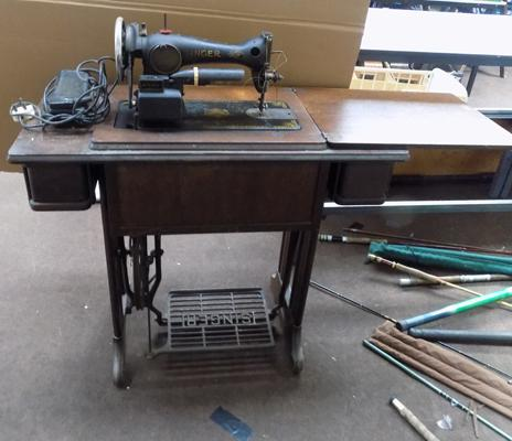 Singer sewing machine on treadmill stand with pedal-sold as seen