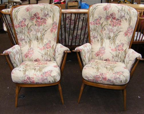 Pair of tall backed Ercol floral patterned armchairs