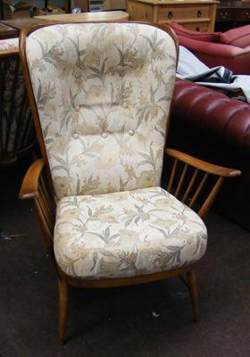 Tall backed floral patterned Ercol armchair