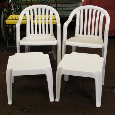 Two plastic garden/patio chairs + two small tables