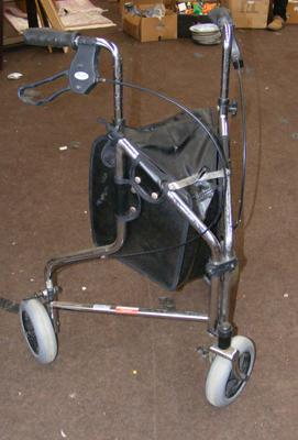 Three wheeled disability walker with brakes & bag