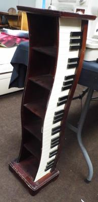 Piano style CD rack