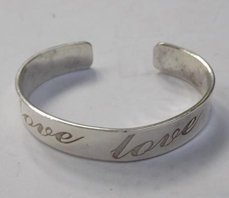 Heavy silver engraved love bangle
