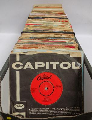 Box of 1960 singles, some in original sleeves