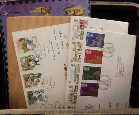 Box containing First day Covers + album of stamps etc...