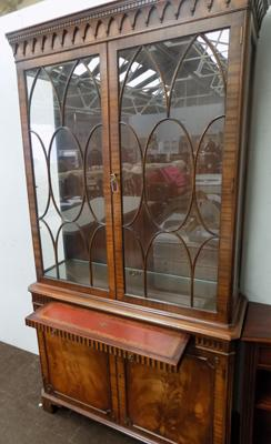 Inlaid drinks cabinet with leather topped shelf