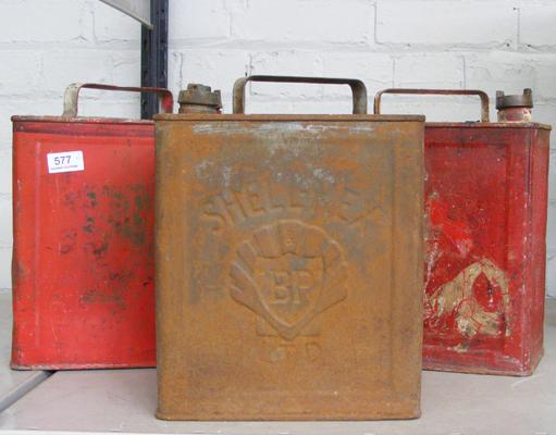 Selection of three vintage petrol cans with original caps
