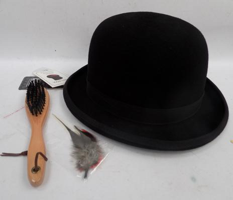 Brand new bowler hat with feather and brush