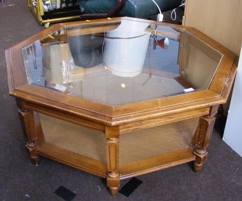 Octagonal glass topped coffee table