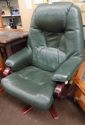 Green leather swivel armchair