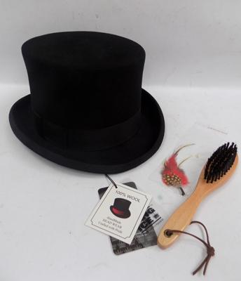 Brand new top hat with feather and brush