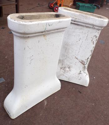 Pair of white porcelain pedestals approx 23 inches tall