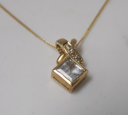 9ct gold chain and 9ct gold pendant set with aquamarine and diamonds