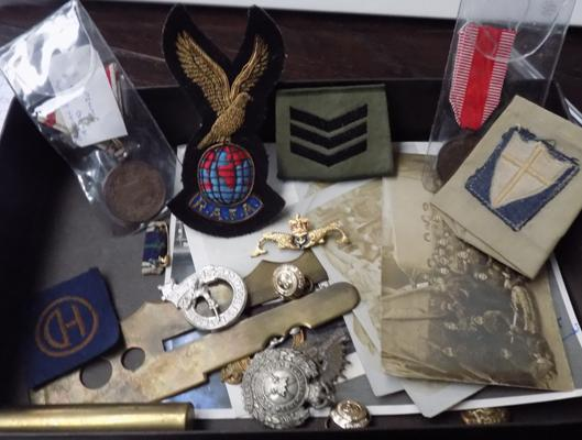 Good collection of WWI and WWII cap badges, button photos, patches etc.