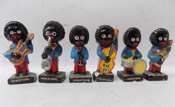 Collection of original vintage Robertson Golly band players, hand painted - bass player damaged