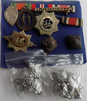 Assortment of military buttons, badges etc.