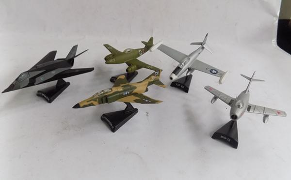 4 diecast cold war jets and 1 WWII German jet on stands