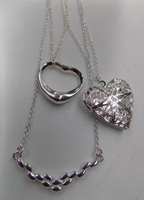 3 silver pendants and chains