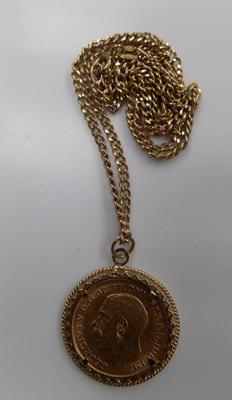 9ct gold mounted 1/2 22ct gold sovereign, 1911 - on 9ct gold link chain