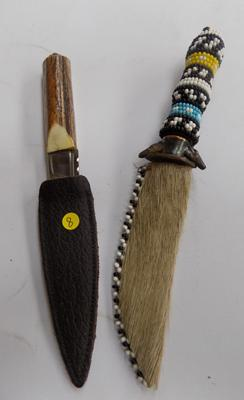 2 decorative knives in sheaths