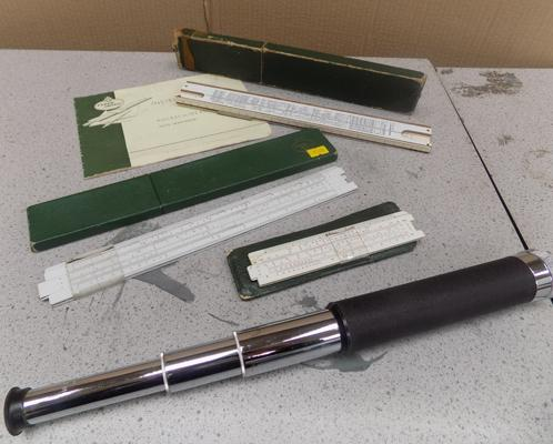 Selection of slide rulers and telescope