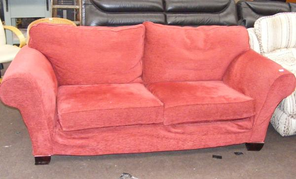 Ruby wine coloured 2-3 seater sofa in good clean condition