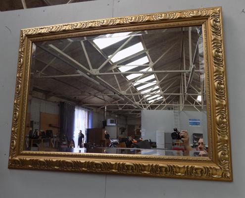 Large gilt framed bevel edge mirror