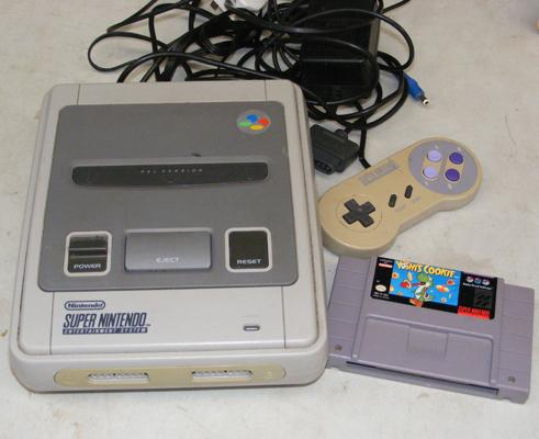 SNES console, controller and Yoshies cookie