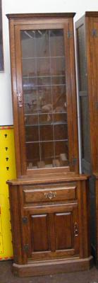 Luptons oak furniture corner cabinet