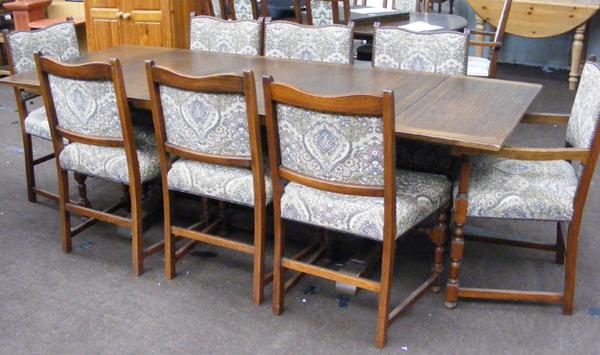 Large extending oak table and eight chairs