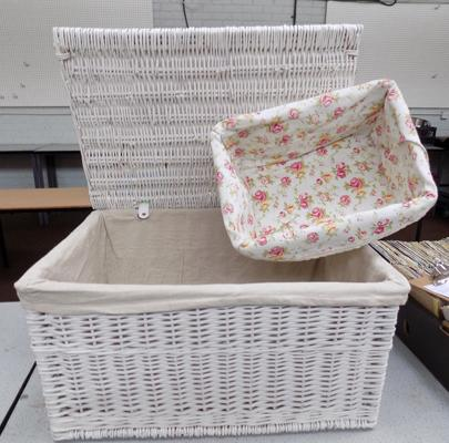 1 large white wicker hamper and 1 smaller wicker basket