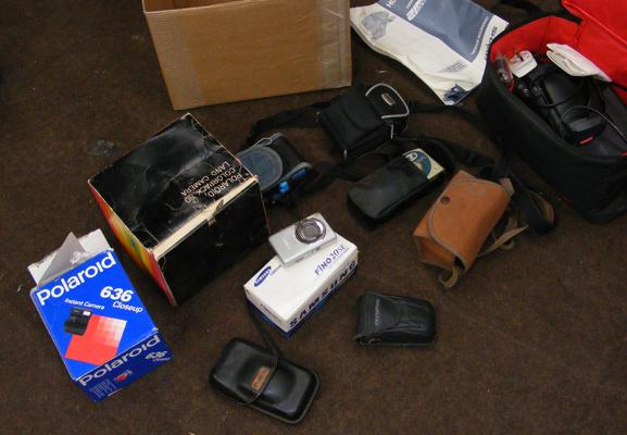 Box of cameras incl. Polaroid instant closeup 636 and colour pack land camera - sharp quick zoom 12 VHS camcorder and bag with instruction manual, charger etc.